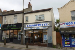 ESTABLISHED LAUNDRETTE TOGETHER WITH A 1 BED FLAT OVER