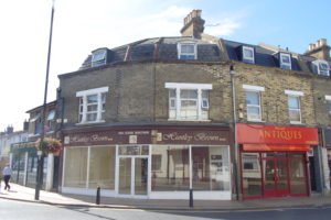 TO LET, RETAIL PREMISES ENJOYING A PROMINENT POSITION
